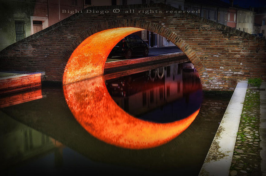 An Illuminated Bridge In Comacchio, Italy