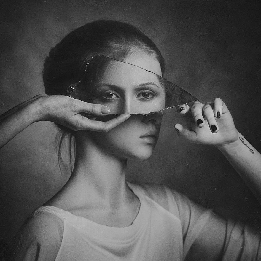 Surreal Self-Portrait With A Mirror Shard by Paul Apal'kin
