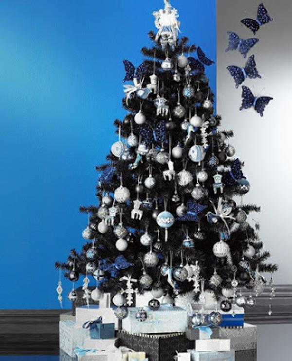 silver-blue-Christmas-tree-decorated-with-non-traditional-ornament-butterfly