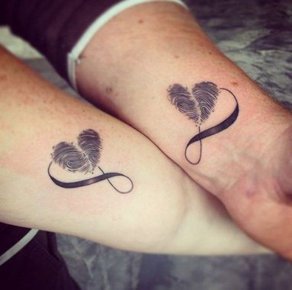 Couple-With-Matching-Infinity-Hearts-Tattoo-On-Wrist